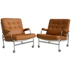 Pair of Bruno Mathsson Brown Leather Karin Lounge Chairs