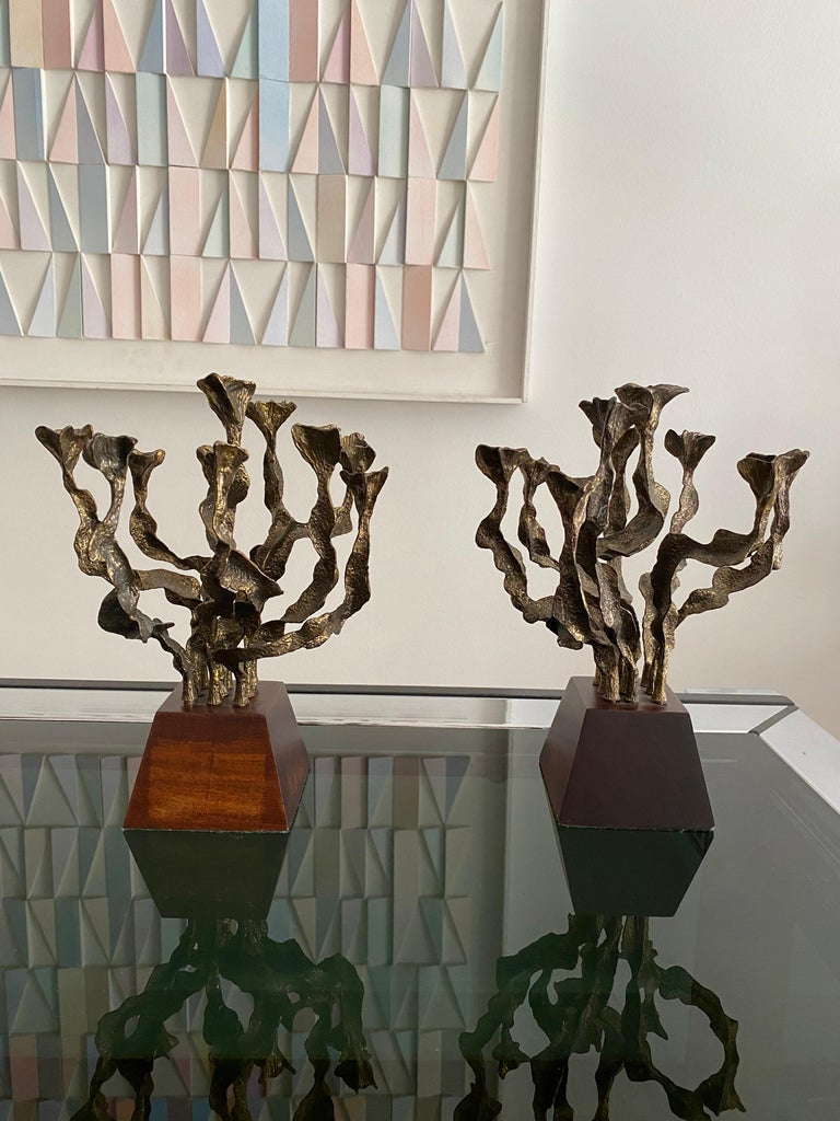 Pair of Brutalist bronze candlesticks with wooden base, circa 1970 Good vintage condition.