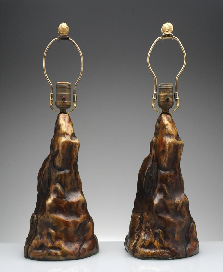 Exceptional vintage pair of bronze table lamps. Lamps are unique and one of a kind. Each lamp is marked with artist initials. Lamps retain the original bronze finial and have a beautiful warm brown patina.