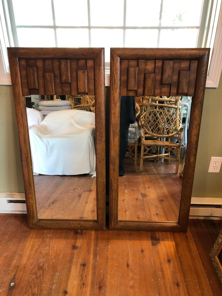 Pair of Brutalist Mid-Century Modern mirrors. Perfect for his and her vanity. Please confirm dimensions prior to purchase.