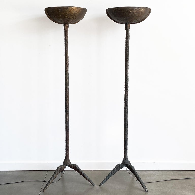 Pair of sculptural solid bronze torchère floor lamps with stylized tripod bases. Brutalist heavily textured hand cast and sculpted patinated solid bronze. Quite heavy and impressive in person! 18