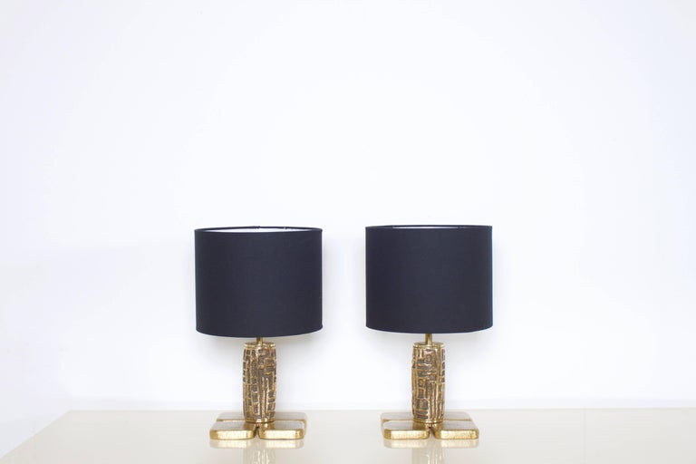 Pair of Brutalist table lamps Luciano Frigerio in very good condition.  Produced by Frigerio di Desio in the 1970s  Heavy massive bronze foot, original cords.  Black shade.  Each Lamp takes a E27 bulb, 75 Watt max.   Luciano Frigerio was