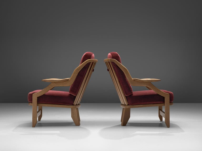 Mid-Century Modern Pair of Burgundy Guillerme and Chambron Lounge Chairs For Sale