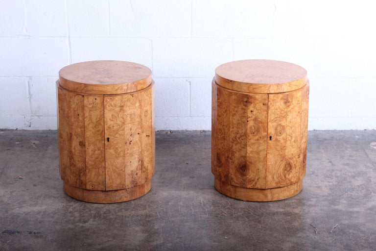 A pair of burled olive tables with bar storage and key. Designed by Edward Wormley for Dunbar. Priced and sold individually.