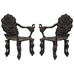 Pair of Burmese Ebonized Carved Armchairs