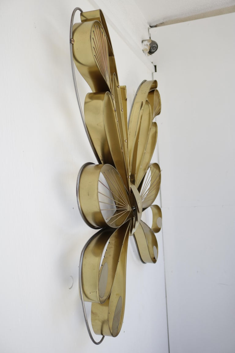 A pair of butterfly sculptures by Curtis Jere made of brass with their original tags.