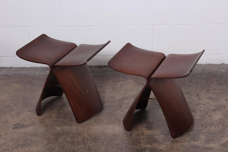 A pair of rosewood butterfly stools designed by Sori Yanagi.
