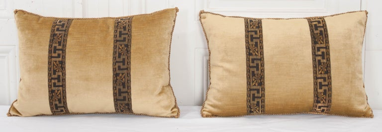 Vintage black and gold Greek key patterned galon on tawny gold velvet. Hand trimmed with vintage gold metallic cording, knotted in the corners. Down filled. Priced for individual sale at $425.00 each.