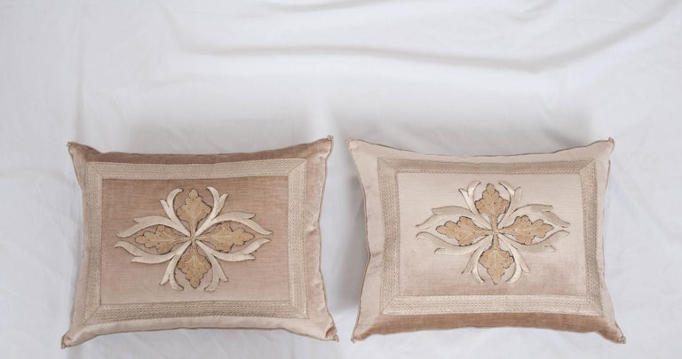 Antique European silver metallic embroidery with beige and pink silk embroidery framed with antique silver metallic galon on pale warm taupe velvet. Hand-trimmed with antique silver metallic cording which is knotted in the corners. Down filled.