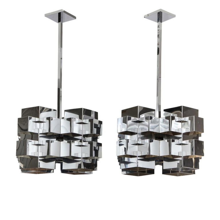 C. Jere cubist chandeliers, chrome steel. Matched pair of nickel-plated chrome cubist form chandeliers by C. Jere for Artisan House of California. Both have been rewired and fitted with custom chrome-plated 24 inch square stock extension rods and