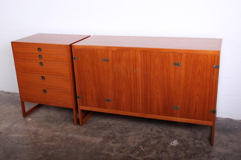 A pair of teak cabinets designed by Børge Mogensen 1957, manufactured by cabinetmaker P. Lauritsen & Son.  Large cabinet: 54.25