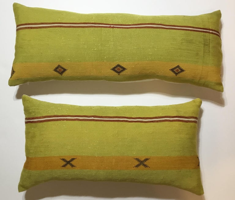 Beautiful pair of pillows made of handwoven flat-weave Kilim textile fragment ,with geometric motifs , unusual funky colors of black muster and lime, fine silk backing and fresh inserts.
