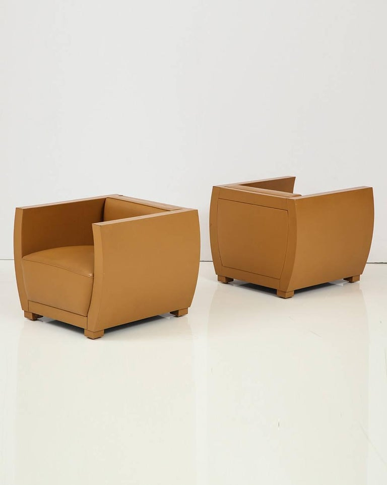 Pair of camel colored leather clad club chairs.