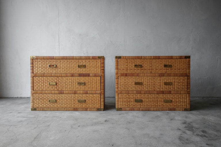 Authentic vintage pair of campaign cane and brass 3 drawers chests. Use them in any space where you are looking to add symmetry. They would be great as oversized nightstands, they could also be placed side by side or on top of each other as a
