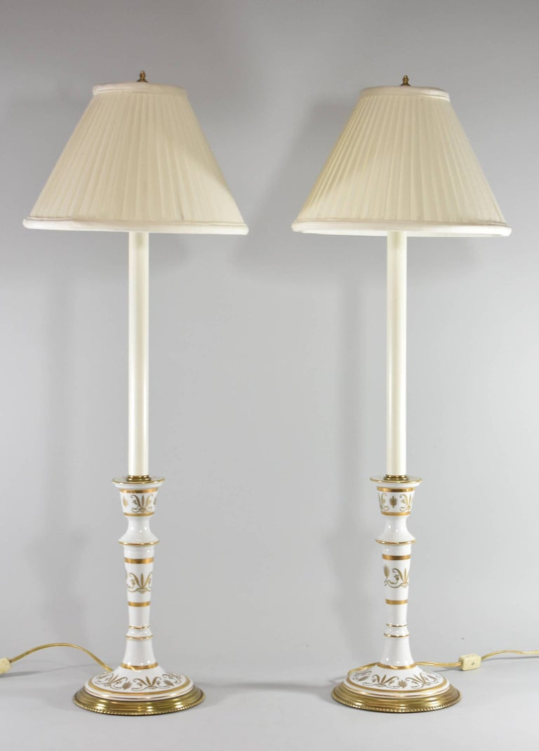 Pair Of Candlestick Form Porcelain And Brass Table Buffet