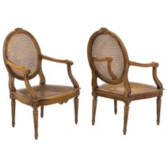 Pair of Cane Louis XVI Style Armchairs in Walnut, 19th Century