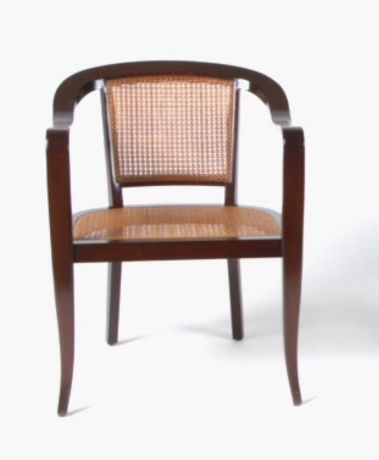Pair of Edward Wormley for Dunbar style bentwood and cane chairs, circa 1950s. Midcentury stylish arm chairs. Currently being refinished.