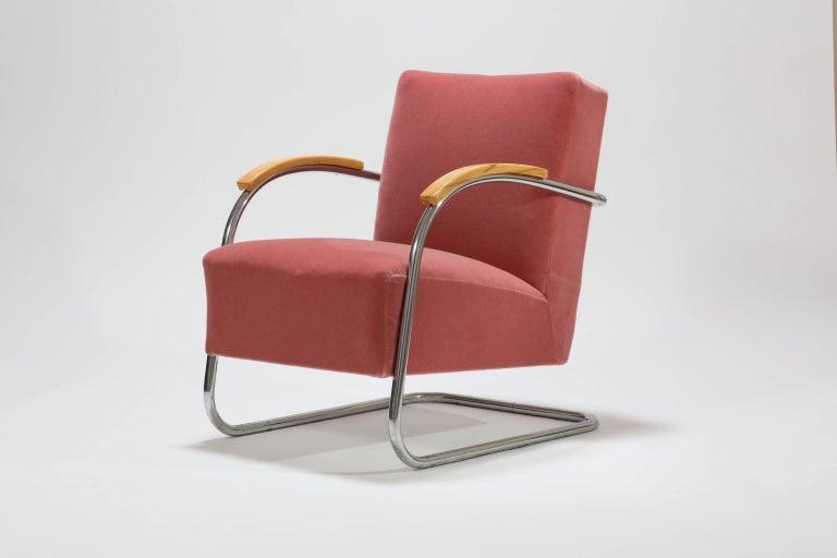 A pair of original tubular steel armchairs from the 1930s. The cantilever armchairs are typical for the German and Austrian Bauhaus Era. The Armchairs have a tubular steel frame and are upholstered with a Rose Mohair fabric. The original armrests