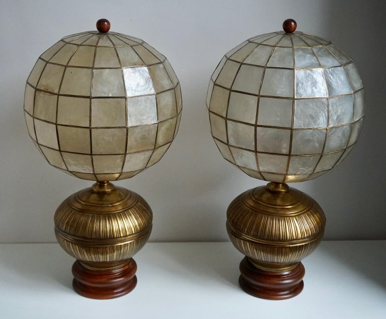 A pair of elegant vintage capiz shell table lamps with copper and wooden base. Perfect working condition and each uses a max. 60 watts light bulb.  Measures: Height 66 cm. Diameter 35 cm.