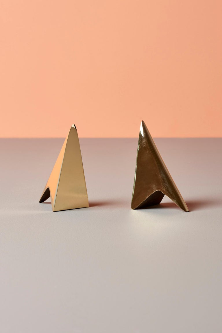 Classic pair of Carl Auböck bookends in a patina and polish brass mix.