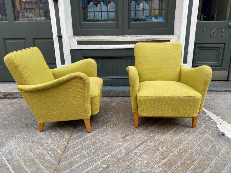 Pair of Carl Malmsten for DUX upholstered lounge chairs. Great sculptural arms that continue down the fronts of the chairs. Chairs date to the late 1940s or early 1950s Fabric is in pretty good shape, thinking they had been re-upholstered in the