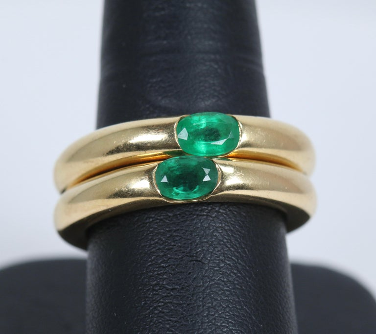 Modern Pair of Cartier Yellow Gold Bands with Single Emeralds For Sale