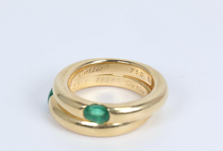 Emerald Cut Pair of Cartier Yellow Gold Bands with Single Emeralds For Sale