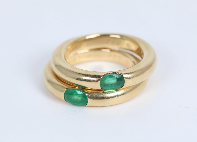 Pair of Cartier Yellow Gold Bands with Single Emeralds In Good Condition For Sale In Dallas, TX