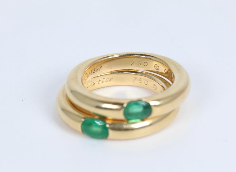 Women's or Men's Pair of Cartier Yellow Gold Bands with Single Emeralds For Sale