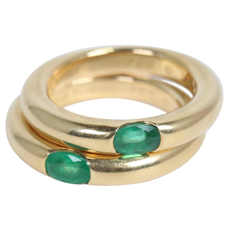 Pair of Cartier Yellow Gold Bands with Single Emeralds For Sale
