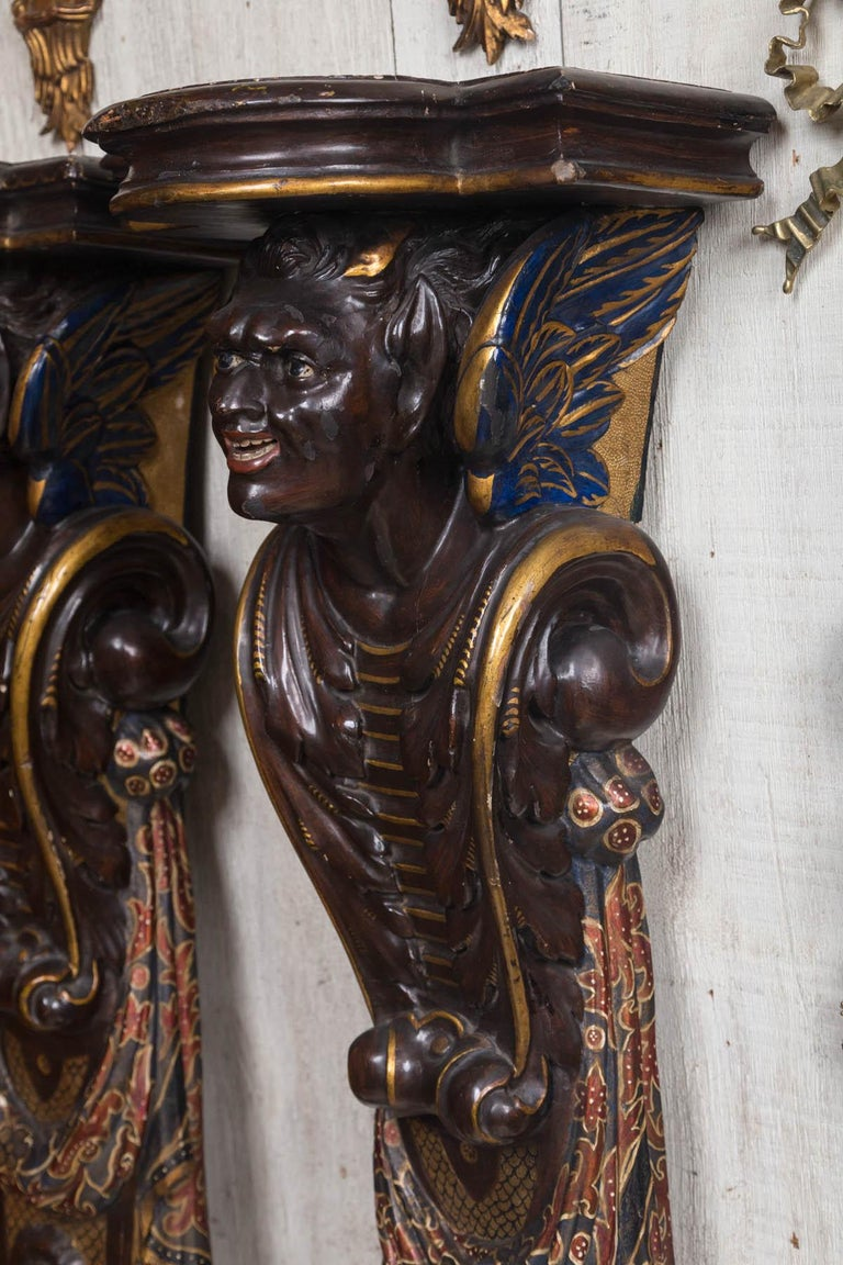 Pair of Carved and Painted Wood