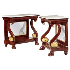Pair of Carved and Stenciled Mahogany Pier Tables