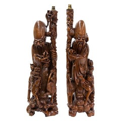 Pair of Carved Chinese Figural Lamps