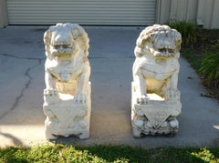Pair of Carved Chinese Marble Foo Dogs Sitting on Decorative Plinths, C. 1850