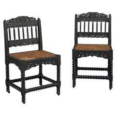 Pair of Carved Ebony Chairs