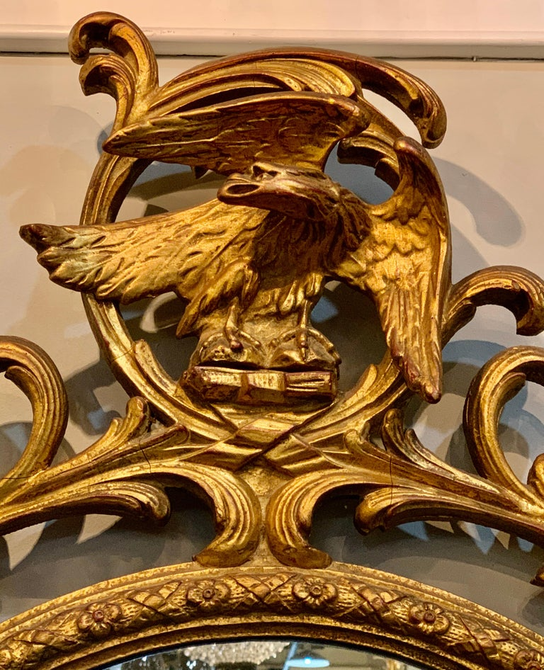 20th Century Pair of Carved Italian Gilt Decorated Carved Eagle Frame Wall Console Mirrors For Sale