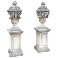 Pair of Carved Limestone Ram Heads Vases on Pedestals
