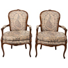 Pair of Carved Louis XV Style Open Armchairs