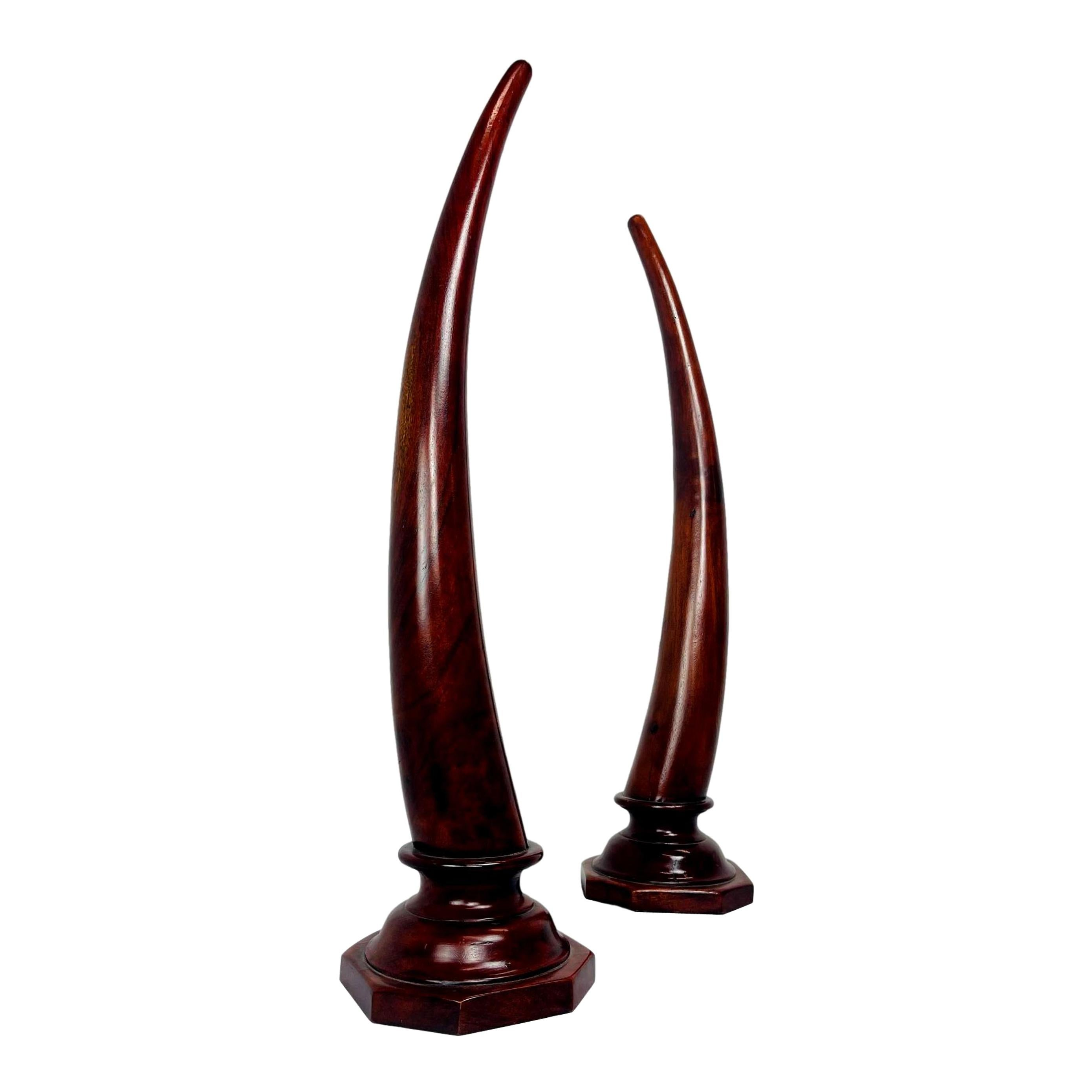 Pair of Carved Mahogany Tusks