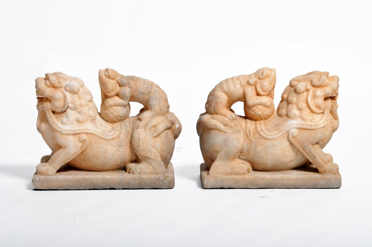 """Often referred to as """"Foo Dogs"""" or """"Fu Dogs"""" in western culture, these handsome stone sentinels are iconic gatekeepers seen throughout Asia. Traditional symbols of protection, they are made from durable materials like bronze, stone, or marble and"""