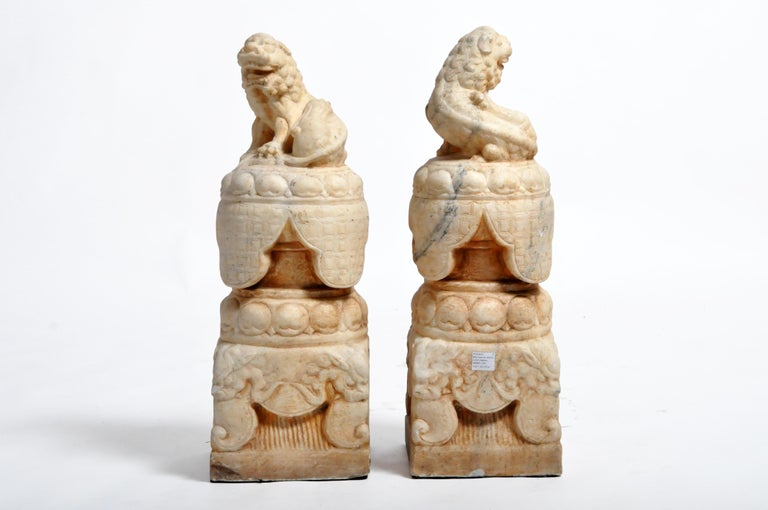 Chinese Pair of Carved Marble Fu Dogs on Pedestal For Sale