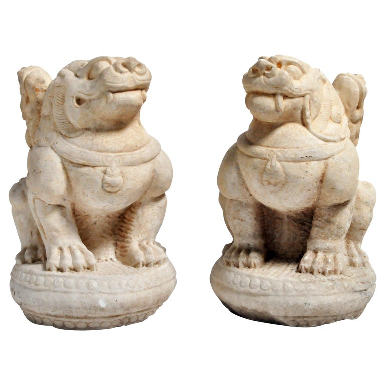 Pair of Carved Marble Fu Dogs on Pedestals For Sale