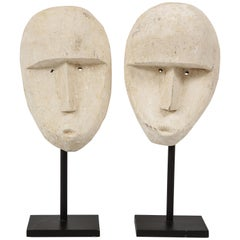 Pair of Carved Modernist Plaster Mask Sculptures