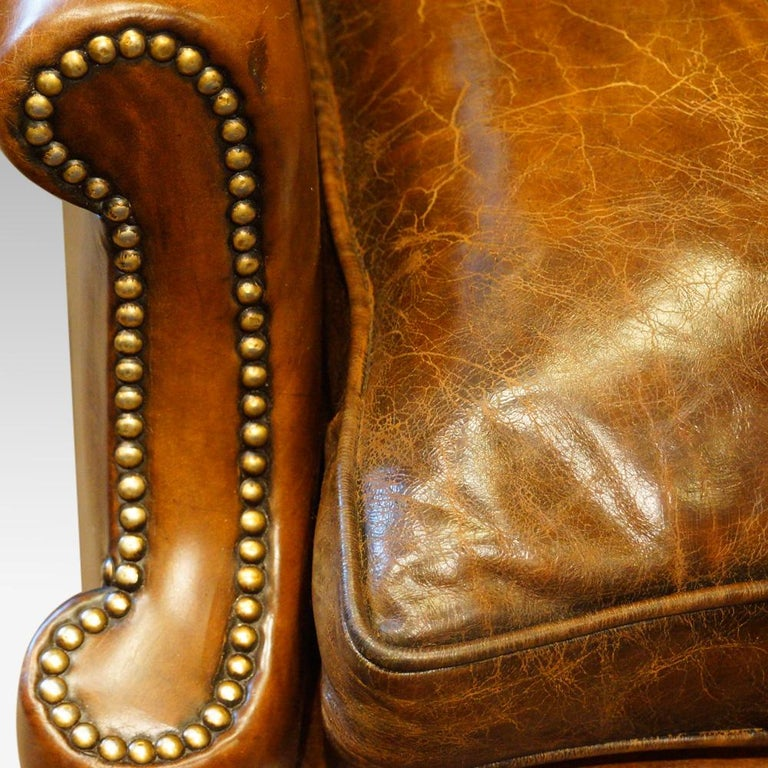 Pair of carved oak and leather wing chairs for sale at stdibs