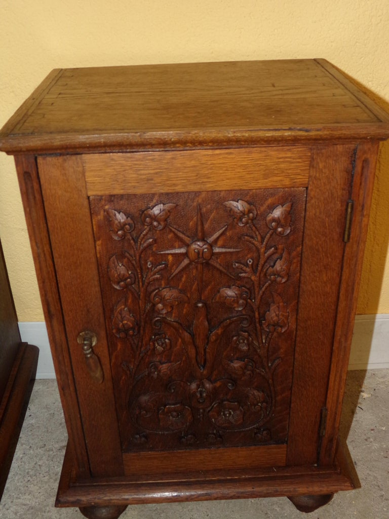 A very attractive pair of carved oak bedside cabinets, C1900.