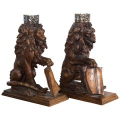 Pair of Carved Oak Seated Lions