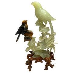 Pair of Carved Russet Jade Bird and Jade Parrot Sculptures