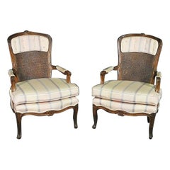 Pair of Carved Walnut French Louis XV Cane Back Upholstered Armchairs circa 1950