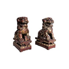 Pair of Carved Wood and Gilt Finished Chinese Foo Dog Figurines or Sculptures