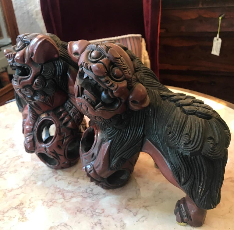 Pair of Carved Wood and Lacquered Foo Dogs In Good Condition For Sale In Lambertville, NJ